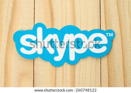 KIEV, UKRAINE - FEBRUARY 19, 2015: Skype logotype printed on paper and placed on wood background. Skype is a telecommunications application software developed by Microsoft. - stock photo