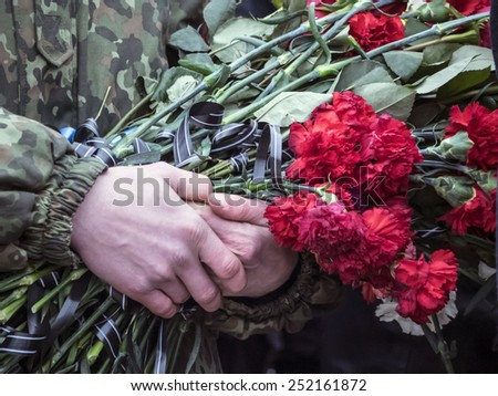 "KIEV, UKRAINE - February 12, 2015: Ukrainians attend the funeral ceremony for servicemen of ""Holy Mary"" battalion Cyril Heinz pseudo ""German"".Cyril Heinz was a citizen of the Russian Federation - stock photo"