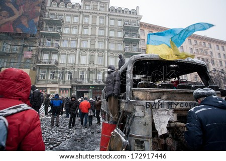 KIEV, UKRAINE - JAN 21: Adult men guard the burned city from policemen on the barricades of occupying snow street during anti-government protest Euromaidan on January 21, 2014, in Kyiv, Ukraine  - stock photo