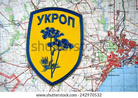 Kiev,Ukraine.JAN 10.Illustrative editorial.Unformal chevron of Ukrainian Army.With map of Mariupol. City and port on Azov Sea.At present time frontline. At January 10,2015 in Kiev, Ukraine - stock photo