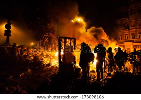 KIEV, UKRAINE - JAN 24, 2014: Mass anti-government protests in the center of the Ukrainian capital Kiev. Waiting to storm by government troops on Hrushevskoho St.
