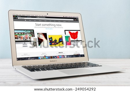 KIEV, UKRAINE - JANUARY 29, 2015: Brand new Apple MacBook Air Early 2014 with home page of Apple Inc. site on screen, designed and developed by Apple Inc., it was released on April 29, 2014 - stock photo