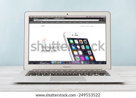 KIEV, UKRAINE - JANUARY 29, 2015: Brand new Apple MacBook Air Early 2014 with page presenting new iOS 8 on screen, designed and developed by Apple Inc., it was released on April 29, 2014 - stock photo
