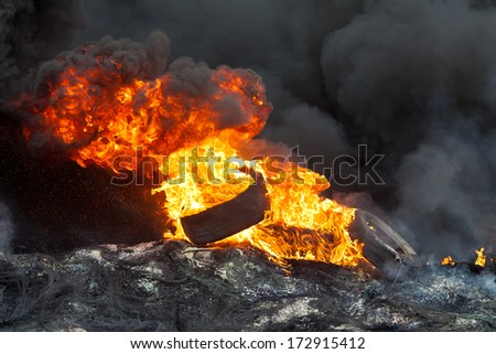 KIEV, UKRAINE - 23 JANUARY 2014: Burning tires at the Independence square during Ukrainian revolution on January 23, 2014 in Kiev, Ukraine. - stock photo