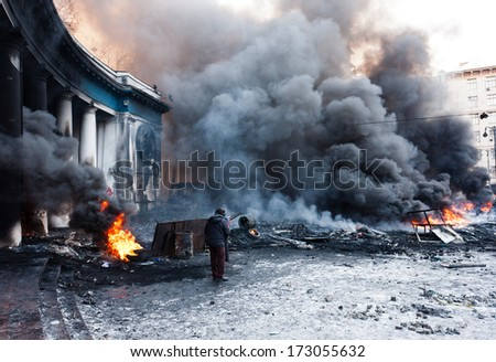 KIEV, UKRAINE - 23 JANUARY 2014: Burning tires near Dynamo Kyiv stadium at the Independence square during Ukrainian revolution on January 23, 2014 in Kiev, Ukraine. - stock photo