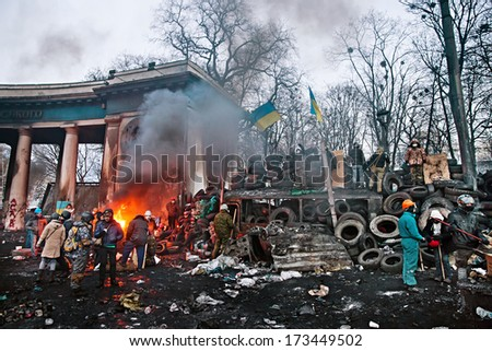 KIEV, UKRAINE - January 26, 2014: Euromaidan protesters rest and strengthen their barricades on Hrushevskoho Street after another night of clashes with riot police in Kiev, Ukraine. - stock photo