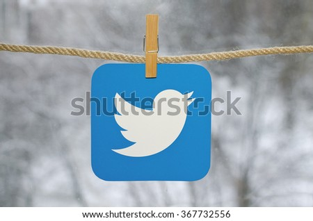 Kiev, Ukraine - January 26, 2016: Popular social media Twitter hanging on the clothesline, against the backdrop of a winter landscape. - stock photo