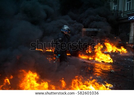 Kiev, Ukraine - 19 January, 2014: Revolution in Kiev. Fire barricades and the protesters