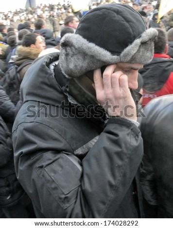 KIEV, UKRAINE -Â?Â? 25 JANUARY 2014: The leader of Ukrainian opposition Vitali Klitschko visits the burial ceremony of Ukrainian revolutionary hero Michail Zhiznevskij on January 25, 2014 in Kiev, Ukraine - stock photo