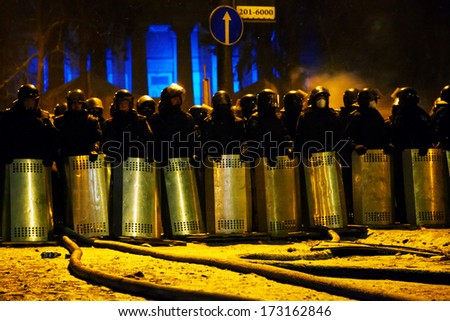 KIEV, UKRAINE - JANUARY 23: The riot police at Hrushevskogo street on January 23, 2014 in Kiev, Ukraine. The anti-governmental protests turned into violent clashes during last week. - stock photo
