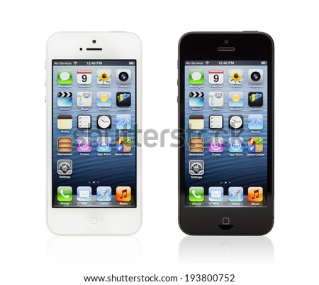 KIEV, UKRAINE - JANUARY 9, 2013: Two brand new black and white Apple iPhone 5, sixth generation version of the iPhone, designed and developed by Apple Inc., it was released on September 21, 2012. - stock photo