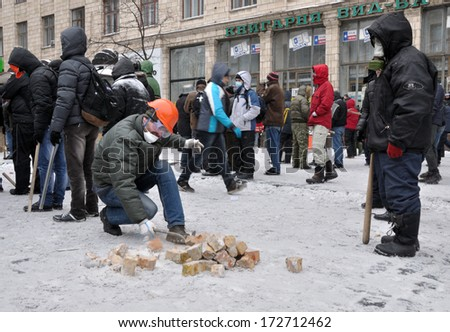 KIEV, UKRAINE � 22 JANUARY 2014: Unknown demonstrators fight with police in government district on January 22, 2014 in Kiev, Ukraine.