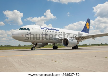 Kiev, Ukraine - July 5, 2014: Lufthansa Airbus A319 taxiing to the gate after landing - stock photo