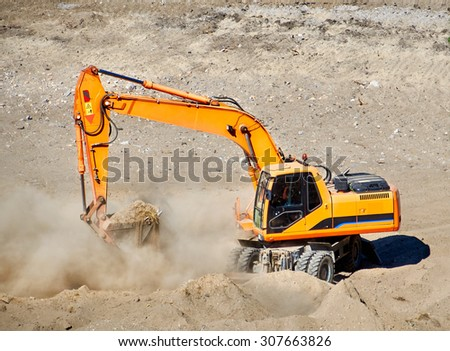 Kiev, Ukraine - July 21, 2015: Reconstruction of school stadium while all the students are on holidays. Heavy machinery is used: bulldozers, excavators, tractors. - stock photo