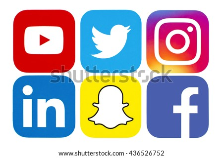 Kiev, Ukraine - June 1, 2016: Collection of popular social media logos printed on paper: Facebook, Twitter, Snapchat, Instagram, LinkedIn and YouTube.