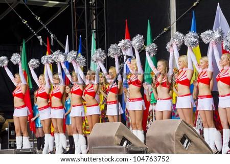 "KIEV, UKRAINE, JUNE 8, 2012: Euro 2012 main Football Fan zone opening on Main Street of Ukrainian capital - Khreshchatyk. Gymnastics and dance group ""Red Foxes"". Kiev, Ukraine, June 8, 2012 - stock photo"