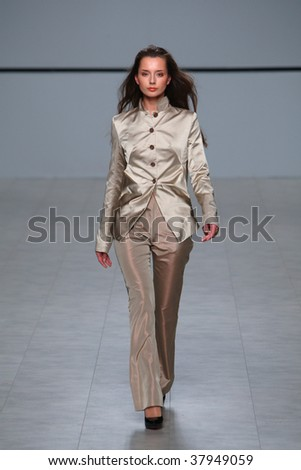 "KIEV, UKRAINE - MAR 17: Model walks the runway during Fashion Show by ""Natalia DOLENKO"" as part of Ukrainian Fashion Week, March 17, 2009 in Kiev, Ukraine."