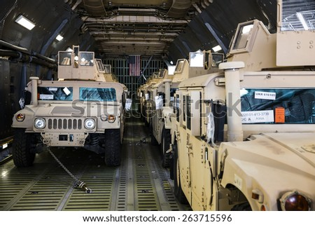KIEV, UKRAINE - Mar. 25, 2015: US armored vehicles HMMWV (Humvee) on board the aircraft of the US Air Forces at the international airport Boryspil in Kiev