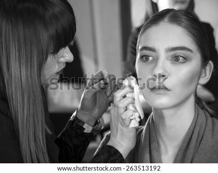 KIEV, UKRAINE - MARCH 18, 2015: A model has her makeup done backstage during Ukrainian Fashion Week - stock photo