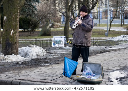Kiev, Ukraine - March 8, 2007: A street musician playing the saxophone
