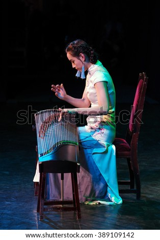 KIEV, UKRAINE - March 1, 2016: Chinese musician. -- In National Opera of Ukraine were  performers on the national Chinese instrument Erhu and Zheng. This concert is dedicated to the Spring Festival - stock photo