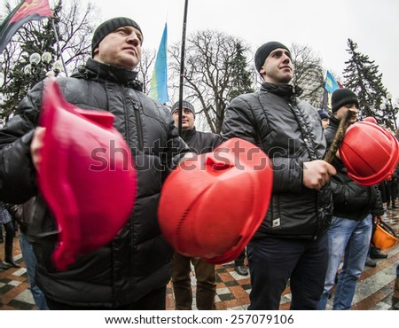 KIEV, UKRAINE - MARCH2, 2015: Employees of coal mining and energy industry in Ukraine hold a rally near the Verkhovna Rada in Kievthey demand to provide funding for normal development of industries.   - stock photo