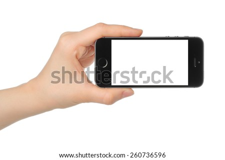 KIEV, UKRAINE - MARCH 7, 2015:Hand holds iPhone 5s Space Gray on white background. iPhone is a line of smartphones designed by Apple Inc.