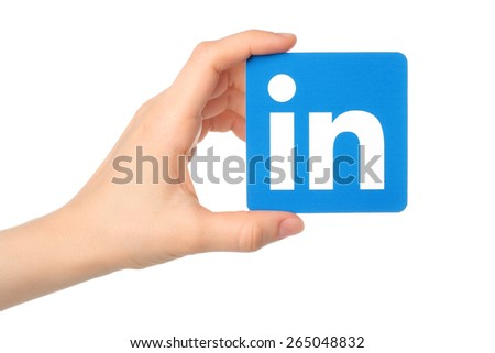 KIEV, UKRAINE - MARCH 7, 2015: Hand holds Linkedin logo sign printed on paper on white background. Linkedin is a business social networking service. - stock photo