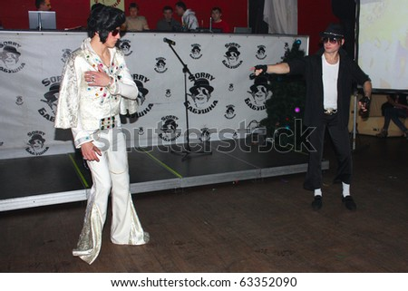 KIEV, UKRAINE - MARCH 9: Man in the Michael Jackson and Elvis Presley  costume taken in the party dedicated to the anniversary of the company Ciklum in the club on March 9, 2010 in Kiev, Ukraine