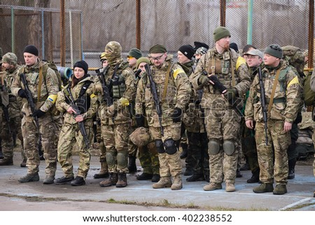 "KIEV,UKRAINE - March 26 : Mens and women in camouflage with models of real weapons waiting for the start of military exercises for civilians ""RUH 100.Tryzub"" in Kiev,Ukraine on March 26,2016."