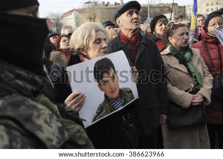 KIEV, UKRAINE - March 1, 2016: Participants of the rally in support of Nadezhda Savchenko threw eggs to the Russian Embassy building in Kiev  - stock photo