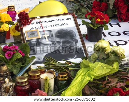 KIEV, UKRAINE - MARCH1, 2015: Portrait of Boris Nemtsov, surrounded by flowers and lamps. -- In Kiev on Independence Square takes action in memory of the Russian opposition leader Boris Nemtsov - stock photo