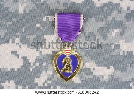 KIEV, UKRAINE - March 6, 2016. Purple Heart award on camouflage uniform