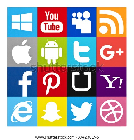 Kiev, Ukraine - March 16, 2016: Set of most popular social media icons: Twitter, Pinterest, Google plus, Facebook, Android, Apple, Youtube, Snapchat, Uber, MySpace and others printed on paper. - stock photo