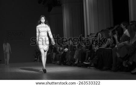 KIEV, UKRAINE - MARCH 19, 2015: The model shows a new collection of  Luba Nazarenko SAYYA at the 36th Ukrainian Fashion Week. - stock photo
