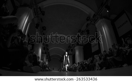 KIEV, UKRAINE - MARCH 19, 2015: The model shows a new collection of  Luba Nazarenko SAYYA at the 36th Ukrainian Fashion Week. - stock photo
