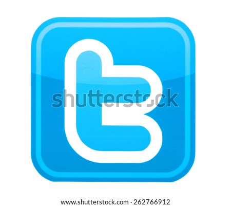KIEV, UKRAINE - MARCH 8, 2015: Twitter logo printed on paper and placed on white background. Twitter is a social networking and microblogging service. - stock photo