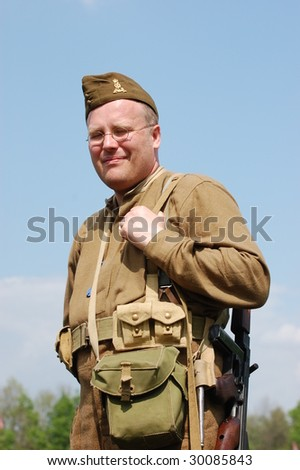 KIEV, UKRAINE - MAY 9:  A member of military history club Red Star in British uniform during historical military reenactment of War in Germany of May 1945 May 9, 2009 in Kiev, Ukraine.