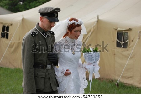 KIEV, UKRAINE - MAY 8 : A members of Red Star history club wear historical German uniform&costume during historical reenactment of 1945 WWII, May 8, 2010 in Kiev, Ukraine.