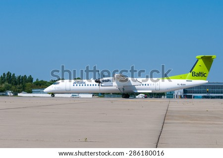 KIEV, UKRAINE - MAY 20, 2015:  Air Baltic propeller airplane taxis to teminal at International Borispol airport on May 20, 2015. Airbaltic is Latvian national airline