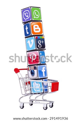 KIEV, UKRAINE - MAY 25, 2015: Cubes with logotypes of social media: Facebook, Twitter, instagram, linkedin, pinterest, viber, tumblr, WhatsApp, Vimeo, blogger  and others  placed into shopping cart . - stock photo