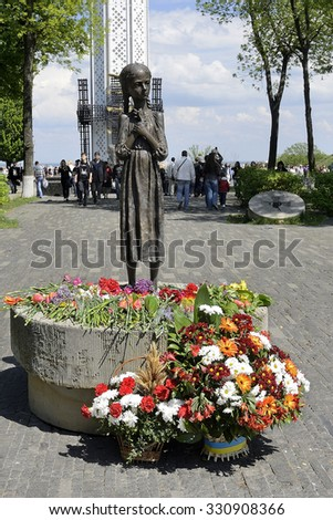 KIEV, UKRAINE-MAY 08, 2015: Day of memory. Flowers of memory near  monument to perished  children  of induced starvation in USSR at 1932-1933 years.
