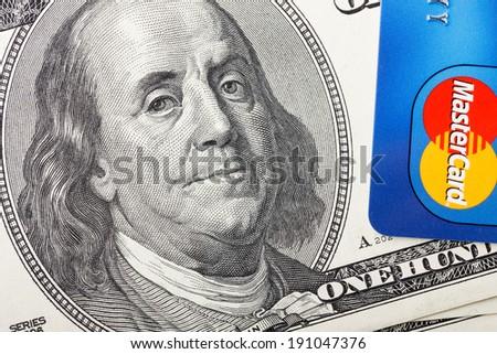 KIEV, UKRAINE - May 5: MasterCard credit card with US dollar bills, in Kiev, Ukraine, on May 5, 2014. - stock photo