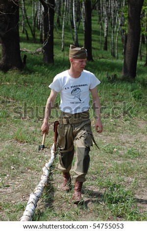 KIEV, UKRAINE - MAY 10 : Member of Red Star history club wears historical American uniforms during participation in 1945 WWII reenactment May 10, 2010 in Kiev, Ukraine.
