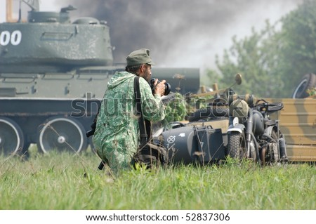 KIEV, UKRAINE - MAY 10 : member of Red Star history club wears historical German uniform during historical reenactment of 1945 WWII, May 10, 2010 in Kiev, Ukraine. - stock photo