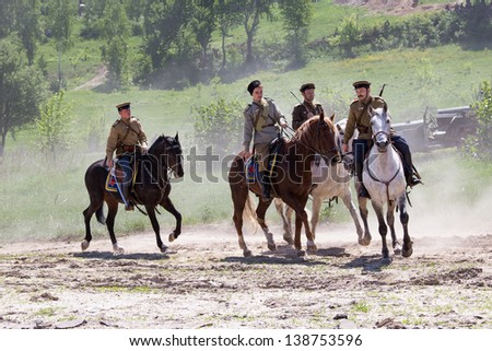 KIEV, UKRAINE - MAY 11 : Members of Red Star history club wear historical Soviet uniform during historical reenactment of WWII on May 11, 20113 in Kiev, Ukraine