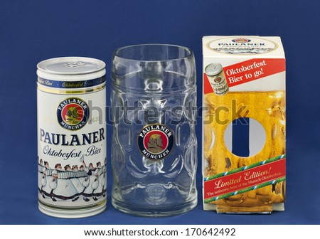 KIEV, UKRAINE - MAY 06, 2012: Paulaner Octoberfest Bier one litre can, mug and limited edition box against blue background. Paulaner is a German brewery established in the early 17th century in Munich