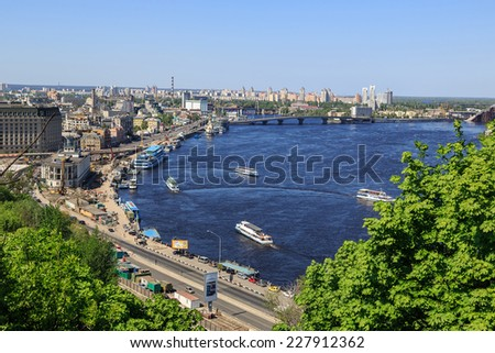 KIEV, UKRAINE - MAY 07: River port and bridge on  a river Dnepr, May 07, 2013, in town Kiev, Ukraine, built in 1157-1961. - stock photo