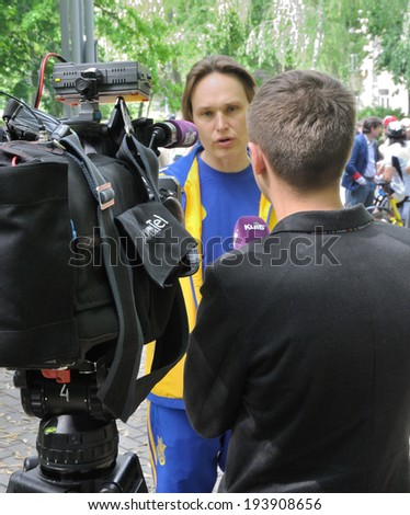 """KIEV, UKRAINE - 17 MAY 2014: The General Manager of Ukrainian National sport complex """"Olimpiyskiy"""" and politic Sergiy Simak gives an interview on May 17, 2014 in Kiev, Ukraine  - stock photo"""