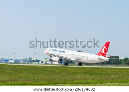 KIEV, UKRAINE - MAY 20, 2015: Turkish Airlines Airbus A321 take off at the Borispol international airport. Turkish Airlines is one of the bigest airlines in the world, has 261 aircrafts. - stock photo